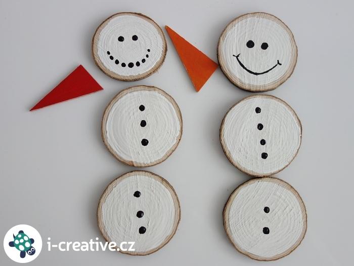 sněhuláci z dřevěných koleček
